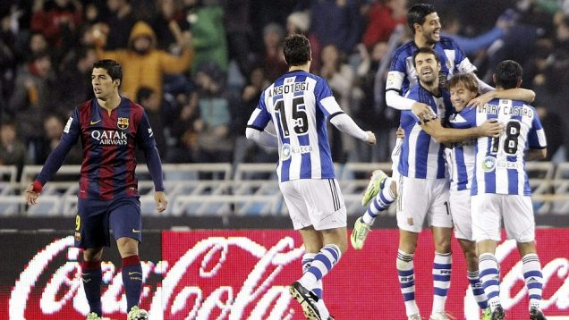 Real Sociedad players celebrate after taking an early lead against Barcelona